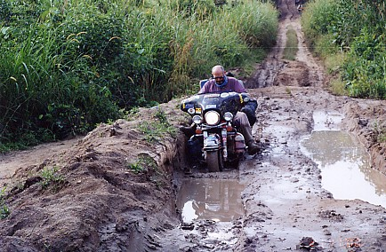 The Harley on muddy roads in the Congo.