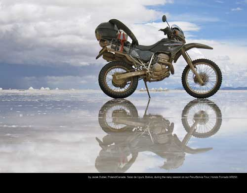February: by Jacek Dubiel, Poland/Canada. Salar de Uyuni, Bolivia, during the rainy season on our Peru/Bolivia Tour; Honda Tornado XR250.