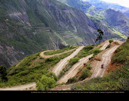 March: by Alberto Lara; of Naomi Tweddle, Canada. The road snakes down and then up in the Peruvian Highlands, on our Canada to Argentina tour; BMW F800GS.