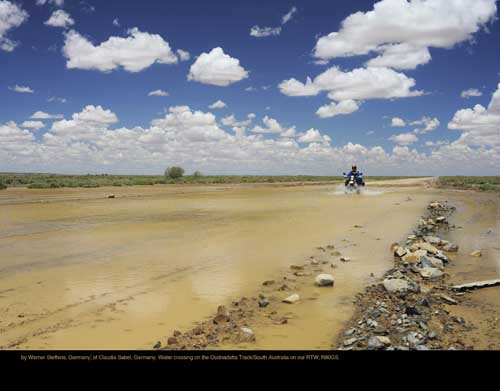 July: by Werner Steffens, Germany; of Claudia Sabel, Germany. Water crossing on the Oodnadatta Track/South Australia on our RTW; R80GS.