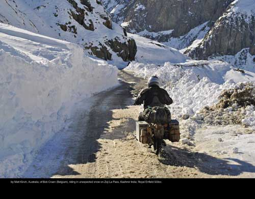 December: by Matt Kinch, Australia; of Bob Craen (Belgium), riding in unexpected snow on Zoji La Pass, Kashmir India; Royal Enfield 500cc.