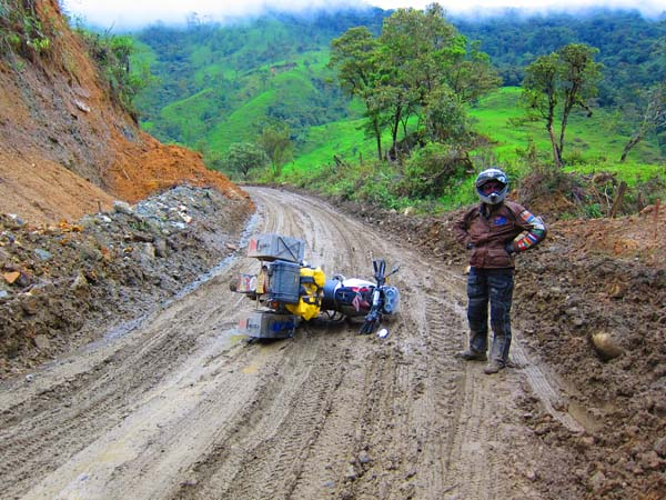 Photo by Angela Perry of herself. Down but not out on my first attempt at serious mud, between Zumba and Vilcabamba, Ecuador on my tour of the Americas, F650GS.