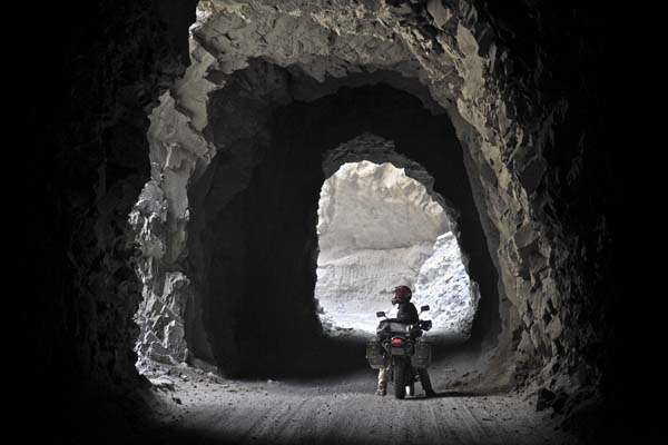 Photo by Austin Shelton, of Nishan Nalbandian, USA; The tunnels of Cañon del Pato in Peru, on Denver to Ushuaia ride, KLR650.