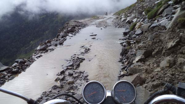 photo by Gregor Zajac, Poland; Crossing Rothang Pass; India tour, Royal Enfield 350ccm.