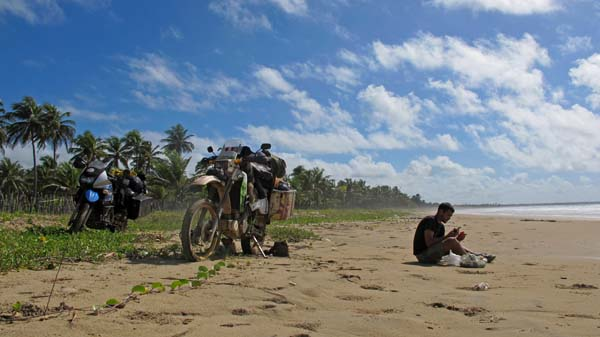 Photo by Marcos Da Fieno, Peru; of Andy, Canada; eating breakfast north of Brasil, on a SA trip, KLR600.