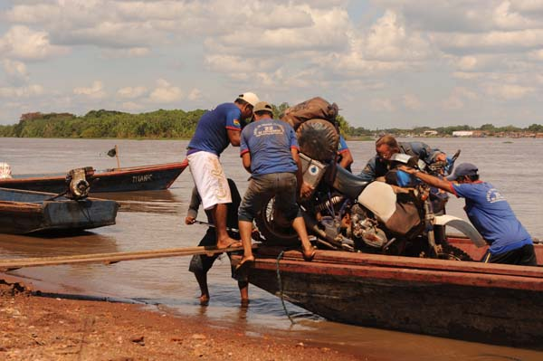 Photo by: Werner Steffens and Claudia Sabel, of Werner Steffens, Germany; Loading the bikes on a boat at the boardercrossing from Bolivia to Brazil, on our RTW trip, R100GS.