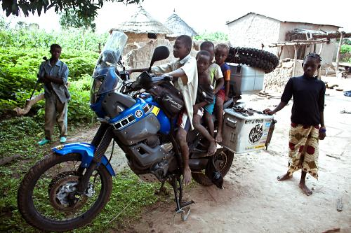 Children on motorcycle, Mali village.